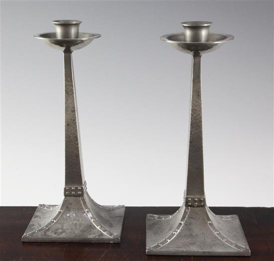 A pair of James Dixon & Sons planished pewter candlesticks, 8.75in.