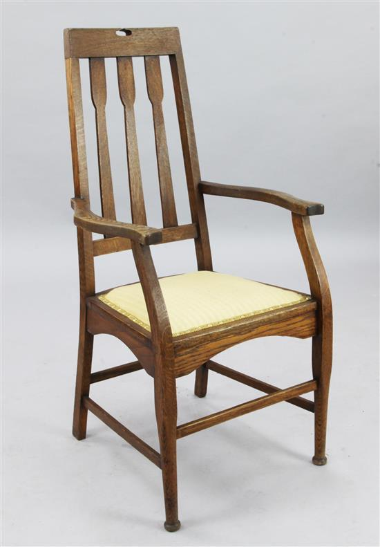 C.R. Macintosh. An Arts & Crafts oak elbow chair, H.3ft 6in.