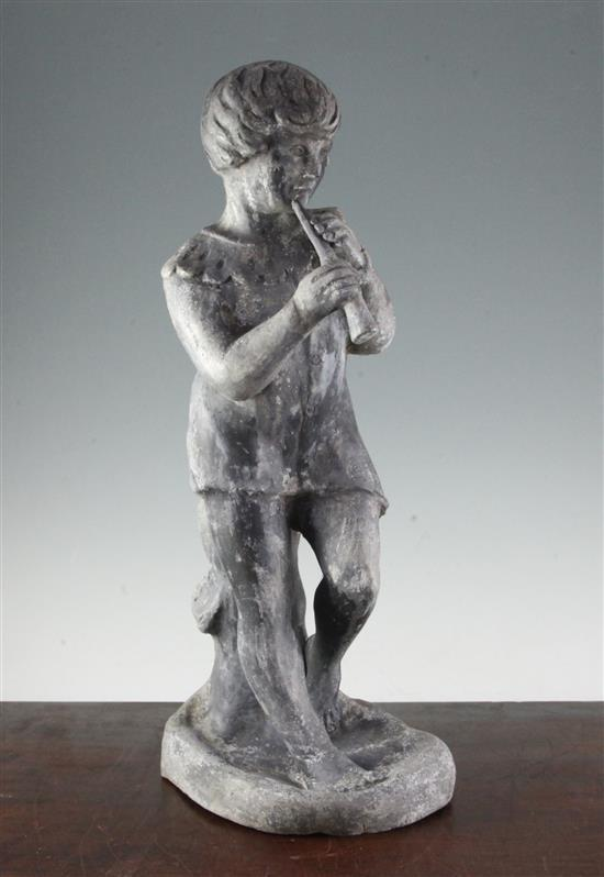 A 20th century lead garden figure modelled as a boy playing a pipe, 22in.