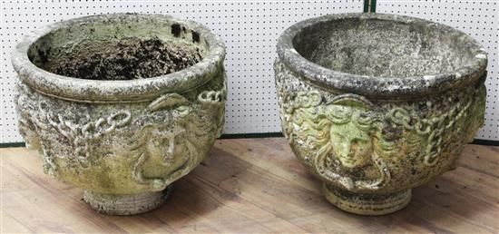 A pair of reconstituted stone garden urns, Diam. 1ft 8in. H.1ft 6in.