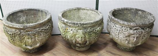 A set of three reconstituted stone garden urns, Diam. 1ft 8in. H.1ft 6in.
