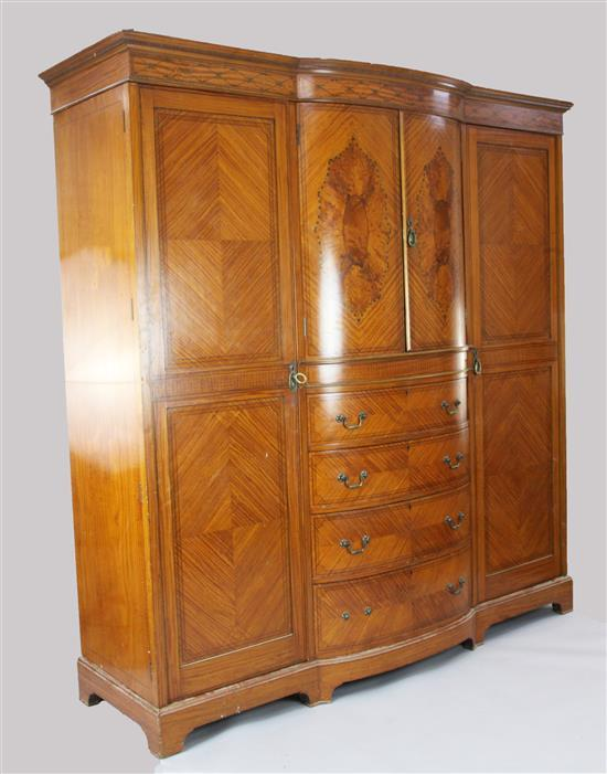 An Edwardian marquetry inlaid satinwood breakfront wardrobe, W.7ft D.2ft 6in. H.7ft 2in.