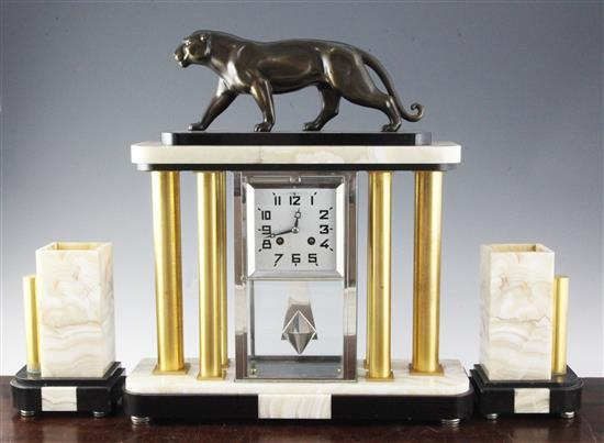 A French Art Deco two colour onyx and marble clock garniture, height 18.5in., vases 8in.
