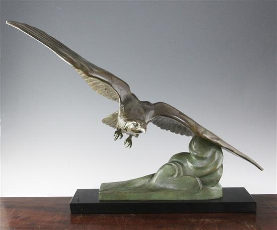 Cartier. An Art Deco bronze group of an eagle swooping over clouds, height 20.5in.