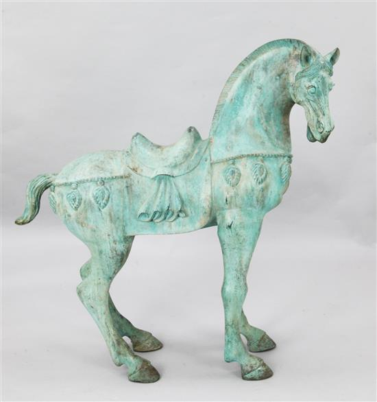 A Tang style bronze horse garden statue, H.3ft 2in.