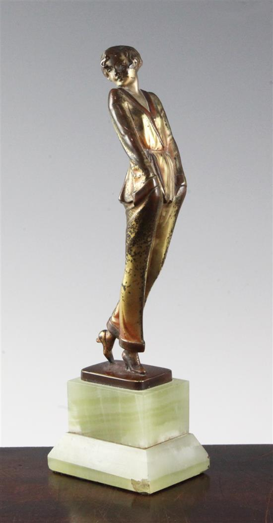 A Lorenzl patinated bronze figure of a young lady wearing a pyjama suit, 9in.