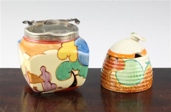 A Clarice Cliff blue autumn pattern sugar jar and a nasturtium honey skep and cover, height 9.5cm & 7.5cm (7.7in. & 6.8in.)