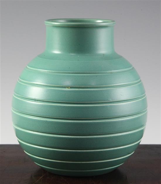 Keith Murray for Wedgwood. A celadon green glaze globular vase, 15.2cm (6in.)