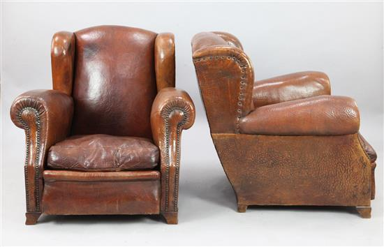 A pair of 1940's French tan leather club armchairs, W.2ft 11in. D.3ft H.2ft 10in.