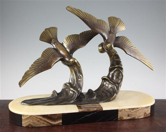 H. Molins. An Art Deco bronze group of two seabirds flying over waves, W.22in. H.16in.