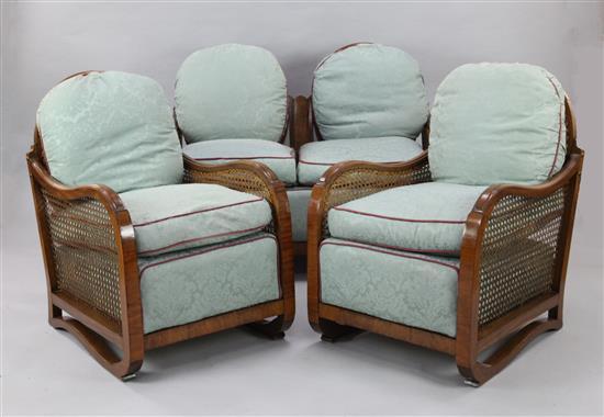 A 1930's walnut three piece bergere suite,