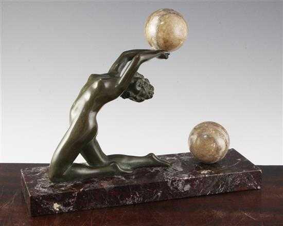 O. Cipriani. A bronze and marble figure of a nude female acrobat with two balls, height 10.5in. width 13.5in.