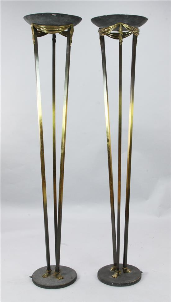 A pair of parcel ebonised brass uplighters, H.5ft 11in.