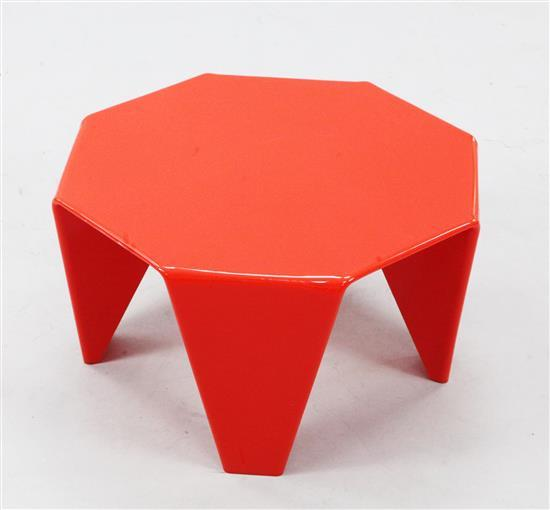 A late 20th century red plastic low table