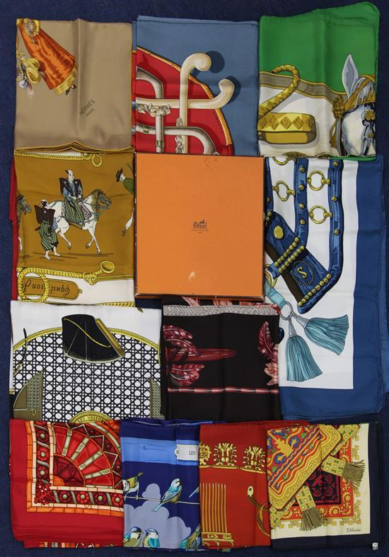 A collection of twelve Hermes silk scarves and one Hermes box,