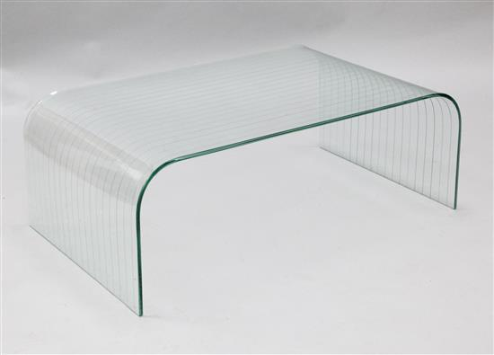 A modern grooved curved glass occasional table, W.3ft 3in. D.2ft H.1ft 2in.