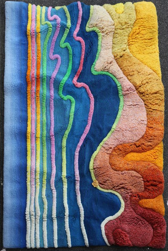 A modern polychrome deep pile wall hanging, designed and made by Ron Nixon, 9ft 3in by 6ft 6in.
