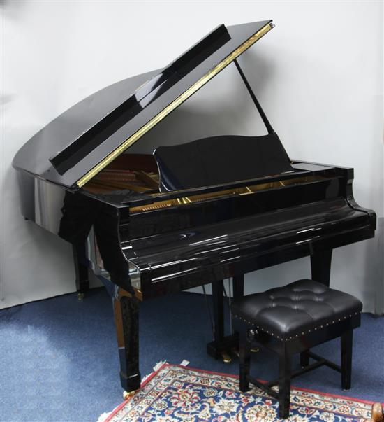 A Yamaha C3 Conservatory grand piano, signed by Danny Grimwood and Robin Howard, W.4ft 9in. D.5ft 11in. H. 3ft 4in.