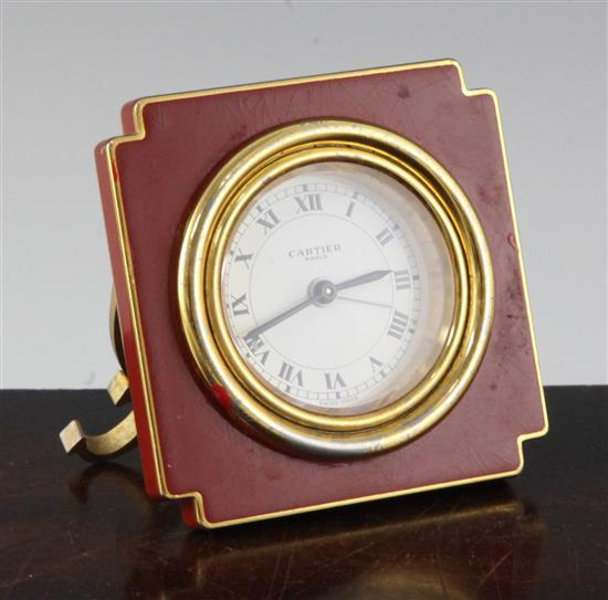 A Cartier of Paris enamelled gilt metal travelling timepiece, 3in.