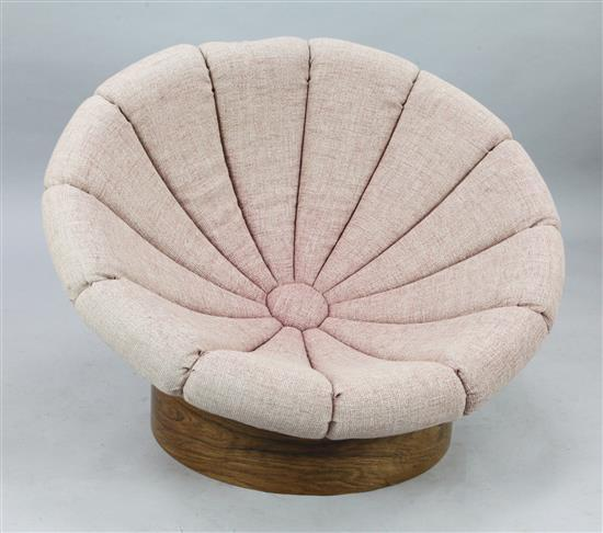 A mid 20th century Italian or Danish fibreglass and rosewood hemispherical lounge chair, Diam. 3ft 5in. H.2ft 1in.