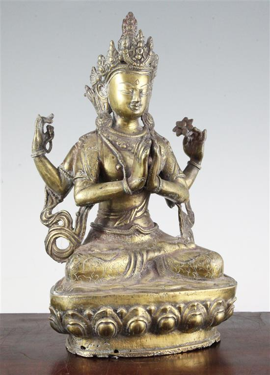 A Tibetan bronze seated figure of Shadakshari Avalokiteshvara, 20th century, 32.5cm