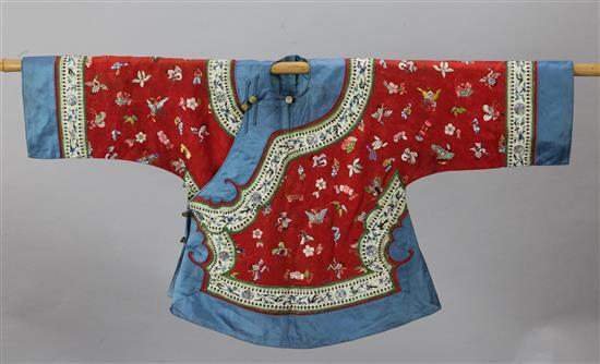 A Chinese red silk damask jacket, c. 1880-1910, length 58cm