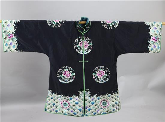 A Chinese black silk satin woman's jacket, 1920s, length 81cm