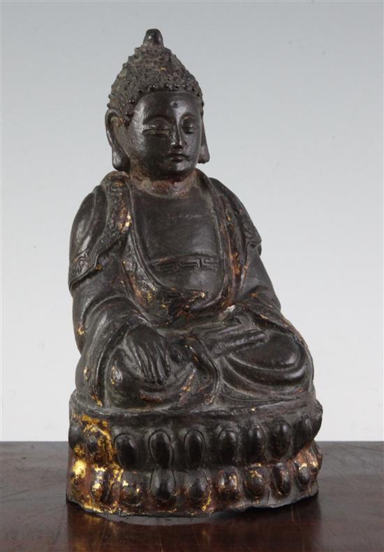 A Chinese gilt lacquered bronze seated figure of Buddha Shakyamuni, 17th century, 22cm