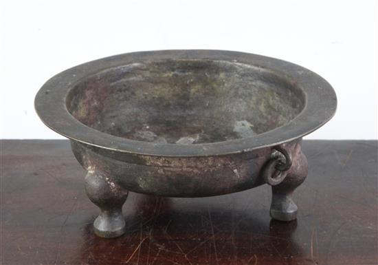 A Chinese archaic bronze tripod vessel, 15.5cm