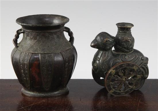 A Chinese small bronze 'phoenix' vase and an archaistic bronze vase, 17th / 18th century, 8.8 and 9.5cm (2)