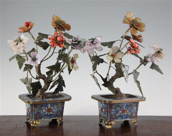 A pair of Chinese hardstone and coral mounted models of trees in cloisonné enamel jardinieres, early 20th century, 30cm, some losses