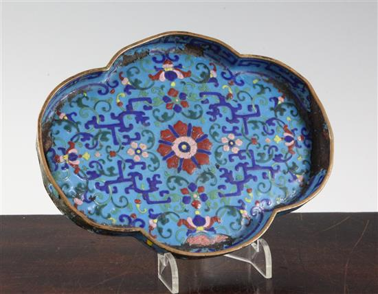 An unusual Chinese enamel on copper quatrefoil-shaped tray, Qianlong four character mark and of the period (1736-95), 18cm, damage and