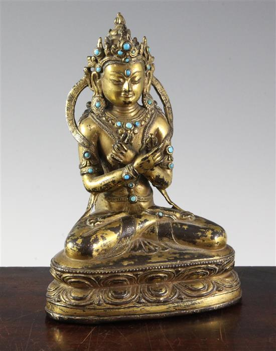A Nepalese gilt copper alloy ''jewelled'' figure of Vajradhara, early Malla period, 15th century, height 20.3cm, later paste and stone