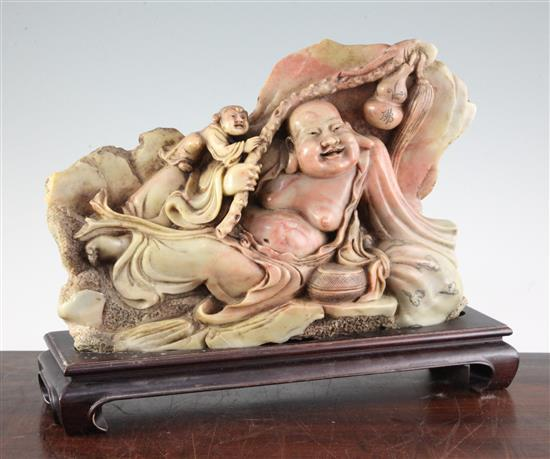 A large Chinese soapstone group of a recumbent Budai and an attendant, mid 20th century, total length 38.5cm