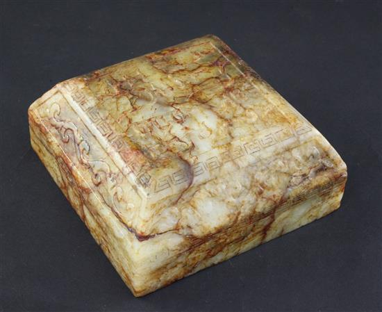 A Chinese archaistic stained and waxed bowenite jade scholar's scroll weight, 11cm