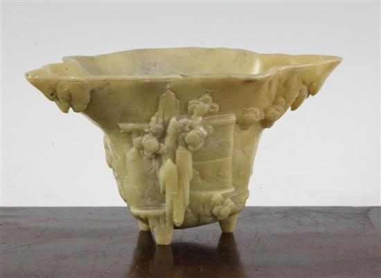 A Chinese pale green soapstone libation cup, 19th century, width 18.5cm, height 10cm, faults
