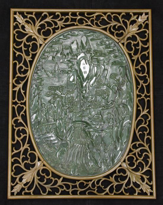 A large Chinese spinach green jade and wood table screen panel, 20th century, total size including wood frame 67 x 53cm, stand lacking