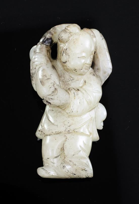 A Chinese white and black jade figure of a boy, 18th / 19th century, 5.8cm