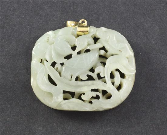 A Chinese celadon jade 'crane and lotus' openwork plaque, Ming dynasty, 4.7cm, later gold mount