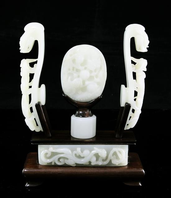 A collection of Chinese archaistic pale celadon jade belt fittings and a white jade archer's ring, 17th-19th century,