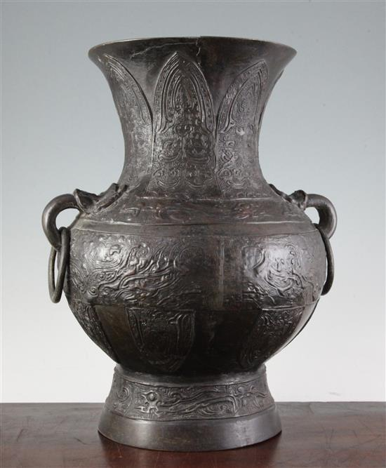 A large Chinese archaistic bronze vase, Hu, Ming dynasty, 38cm, old repairs