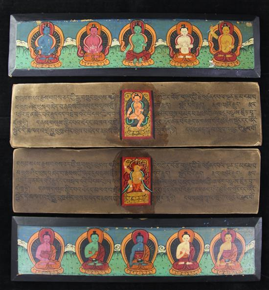 A Tibetan painted wood and leaf sutra, first half 20th century, 9.5 x 36.5cm