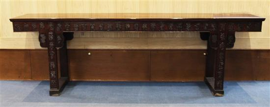 A large Chinese 'Hundred Shou' rosewood (hongmu) altar table, early 20th century, length 258cm, depth 50cm, height 93.5cm, restorations