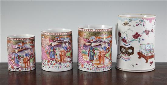 A graduated set of three Chinese export famille rose mugs and another larger, Qianlong period, 10cm-13cm and 16.5cm (4)