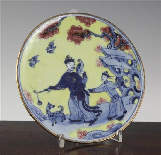 A Chinese yellow ground underglaze blue and copper red opium dish, Kangxi period, 17cm