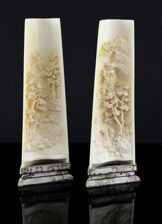 A pair of Chinese ivory wrist rests, early 20th century, 20.5cm, silk brocade covered stands