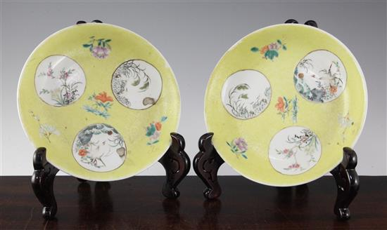 A pair of Chinese yellow ground famille rose medallion dishes, 19th century, 19cm, ground off glaze to base
