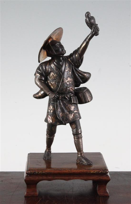 A Japanese two-colour bronze figure of a falconer, by Miyao, Meiji period, total height 26cm, lacking item to left hand