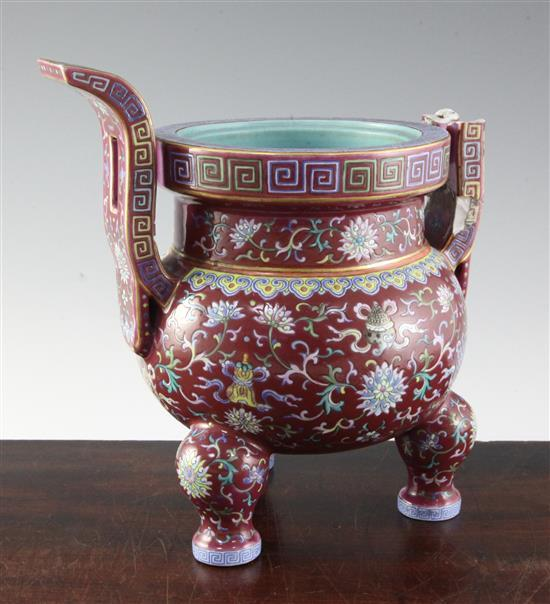 A Chinese famille rose ruby ground tripod censer, Jiaqing six character seal mark and of the period (1796-1820), height 27cm, damage an