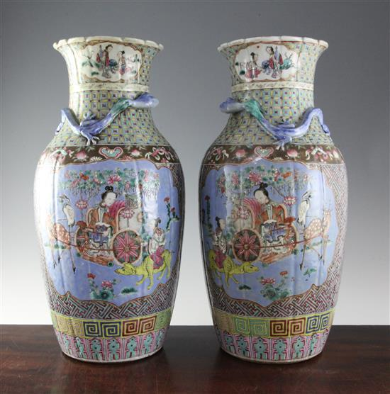 A pair of large Chinese Canton decorated famille rose fluted baluster vases, 45cm